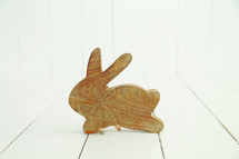 A wooden carving of a rabbit.