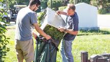 volunteers doing yard work at the church