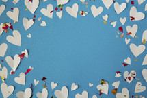 border of paper hearts and confetti