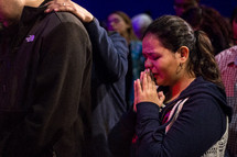 prayers and comfort at a worship service