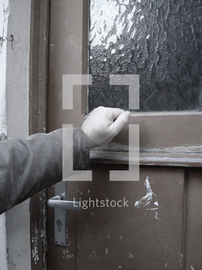 someone knocking at an old door