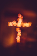 bokeh lights in the shape of a cross