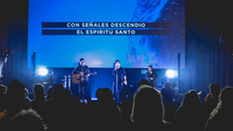 Spanish on a projection screen behind worship leaders