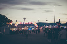a fair midway and crowd