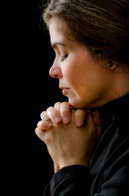 woman in soulful prayer