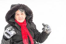 elderly woman outdoors in snow