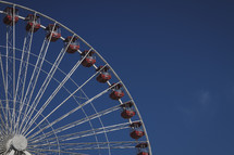 A giant ferris wheel against a blue sky.