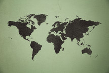 world map printed on an old wall.