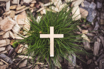 wood cross in grass