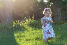 a little girl picking flowers