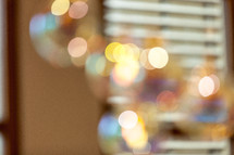 bokeh lights and blinds on windows