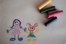 a child's drawing in crayon of a mother and daughter