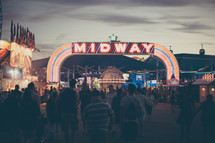 a fair midway sign at night