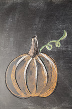 pumpkin on a chalkboard