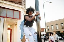 young woman climbing a pole