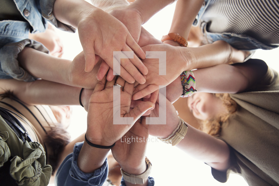all hands in, woman's group prayer