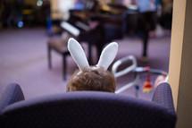 child wearing rabbit ears