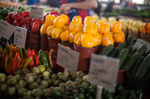 variety of peppers and tomatillos for sale at a farmers market