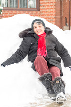 elderly woman sitting in snow