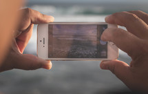 a man taking a picture with an iPhone