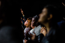 worshipers in prayer and praise
