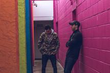 friends talking in an alley