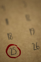 25th circled in red on a calendar