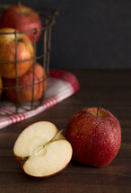 wire basket with red apples
