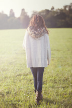 Woman standing in a field.