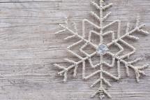 snowflake decor on wood background