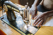woman using a sewing machine