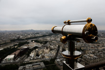 telescope over rooftops of city