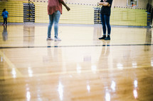 teens standing in a gym