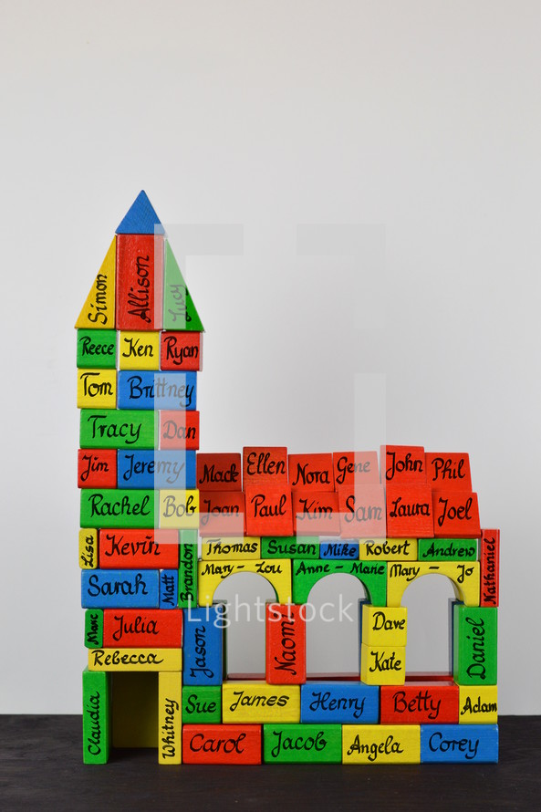 church built out of wooden blocks with names on them as symbol for the community of believers