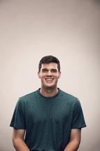 studio portrait of smiling man.