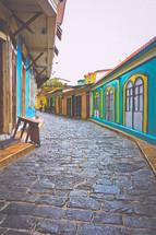 vivid houses along a cobblestone street