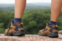 hiking boots on a mountaintop