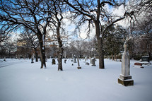 snow covered cemetery