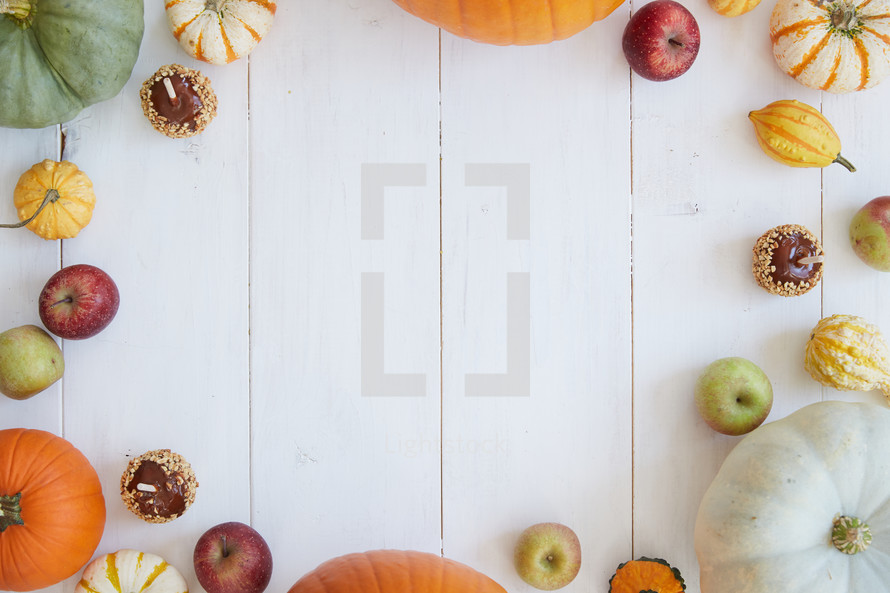 fall border with pumpkins and apples.