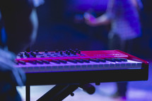 keyboard and band members at a concert