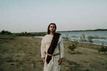 Jesus standing on a shore