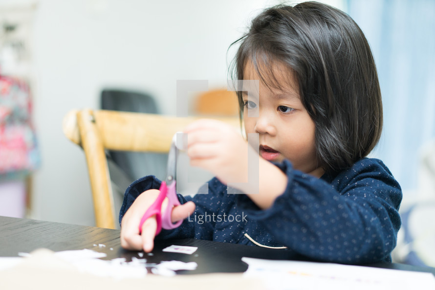 a child cutting paper