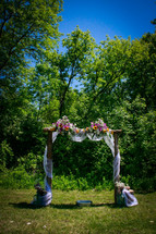 flowers on an archway for a wedding ceremony