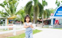 a toddler girl on a farm