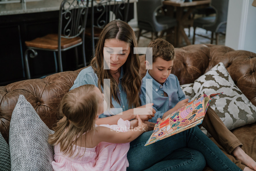 a mother reading to her kids