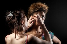makeup artist fixing a model