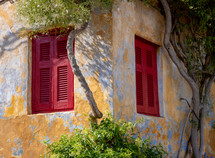 red shutters on windows