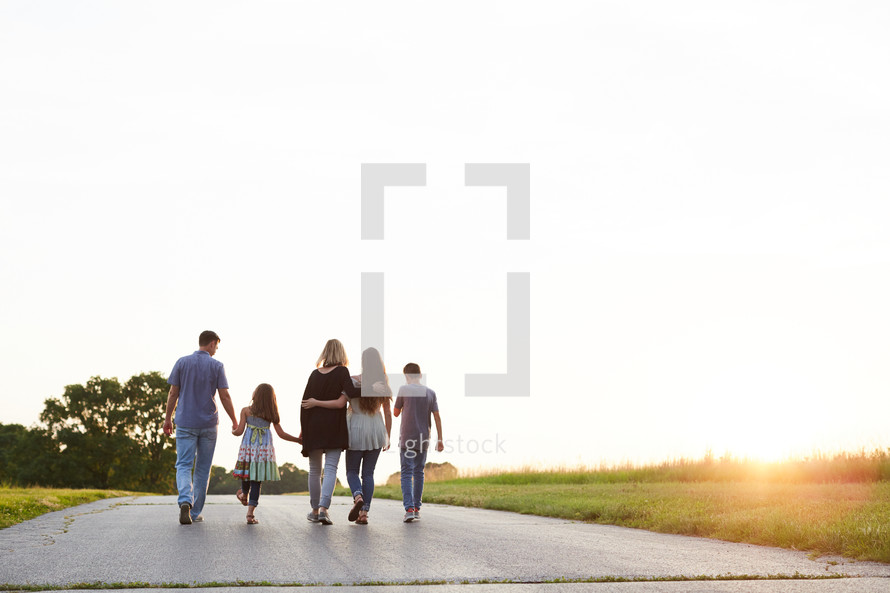 a family walking down a rural road together