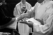 priests preparing communion