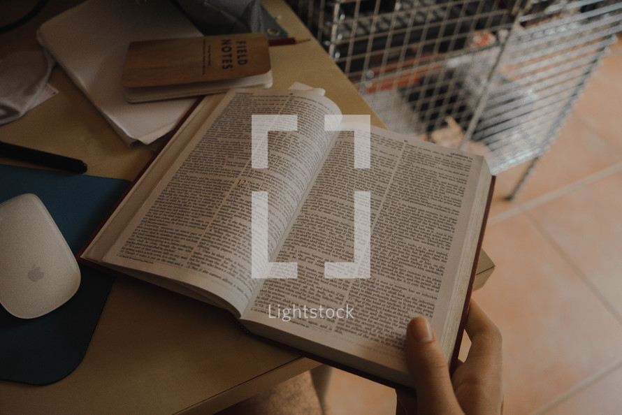 reading a Bible at a desk